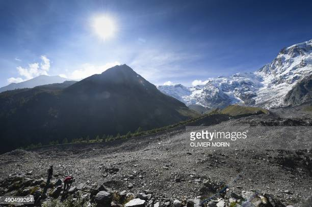 A cameraman works on the Belvedere Glacier on September 26 2015 on the Monte Rosa The Belvedere Glacier is a valley glacier mostly covered by rocks...