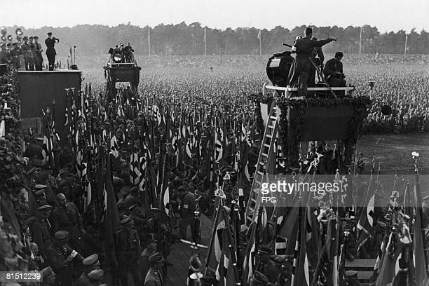 Cameramen and lighting rigs at the Nuremberg Rally to mark the 6th Nazi Party Congress September 1934 The event was filmed by Leni Riefenstahl and...