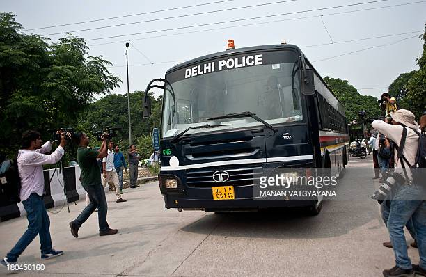 TV cameramen and press photographers take pictures as an Indian police van believed to be carrying the accused in a gang rape case arrives at the...