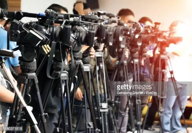 cameramen during event - journalist stock pictures, royalty-free photos & images