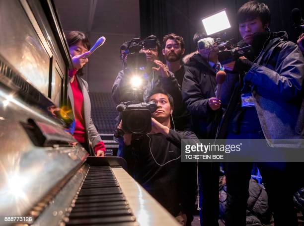 Cameramen film a piano that once was damaged in the 1945 atomic bombing of Hiroshima on December 9 2017 in Oslo Norway where preparations are under...