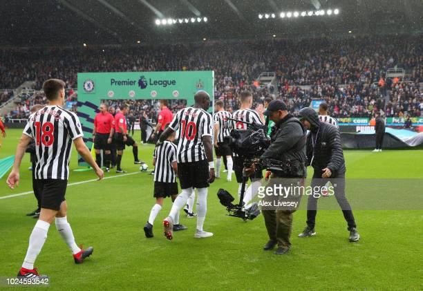 Cameramen film players of Newcastle United and Chelsea as they walk out prior to the Premier League match between Newcastle United and Chelsea FC at...