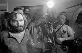 Cameramen film the scene as charles manson is brought into the los picture id515288632?s=170x170