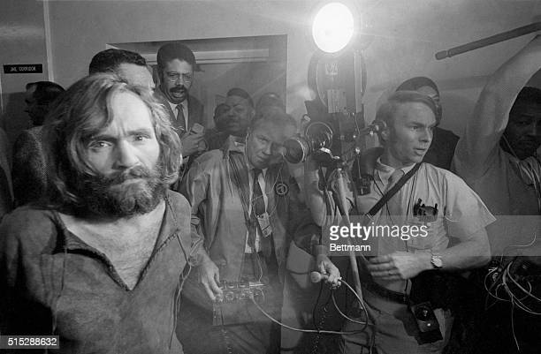 Cameramen film the scene as Charles Manson is brought into the Los Angeles city jail under suspicion of having masterminded the TateLaBianca murders...