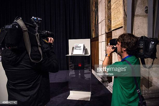Cameramen film the White Book on National Transition as it is unveiled on September 29 2014 in Barcelona Spain The White Book compiles 18 reports...