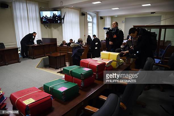 Cameramen get shot of files before the trial of Dutch Jacobus Marinus Van Nierop dubbed as The dentist of the horror on March 8 2016 at the Nevers...