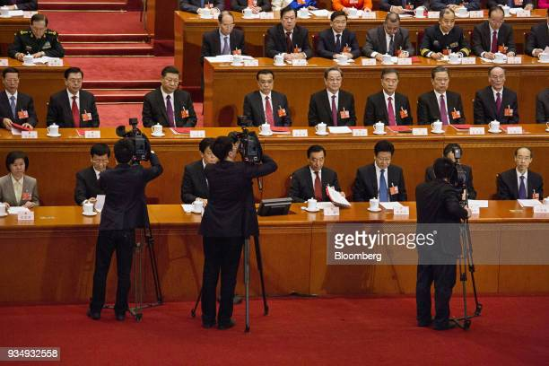 Cameramen stand in front of Zhang Gaoli China's former vice premier second row from left Zhang Dejiang former chairman of the Standing Committee of...