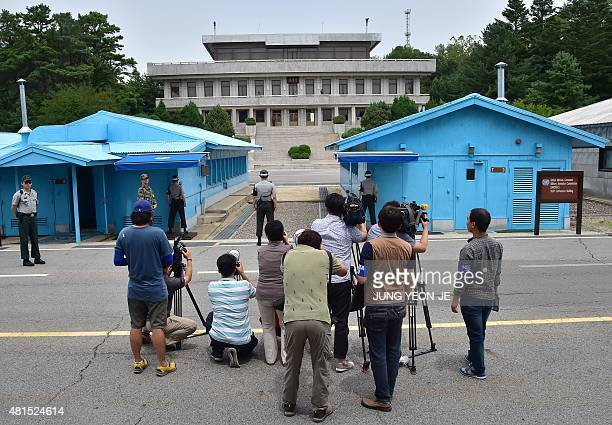 Cameramen take pictures of North Korean side during a press tour to the truce village of Panmunjom in the Demilitarized zone dividing the two Koreas...