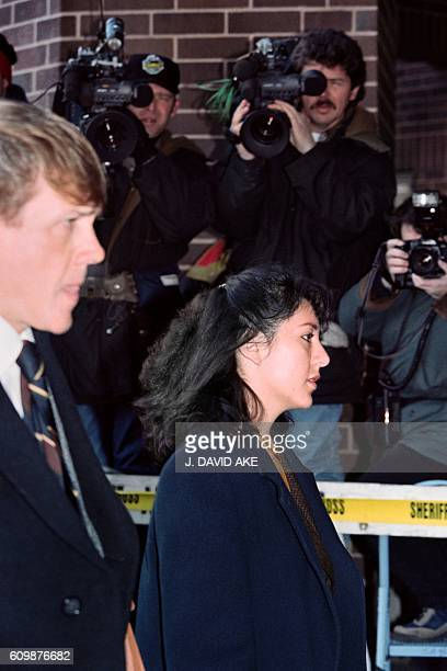 Cameramen train their cameras on Lorena Bobbitt as she arrives at the Prince William County Courthouse in Manassas on January 11 1994 for her trial...