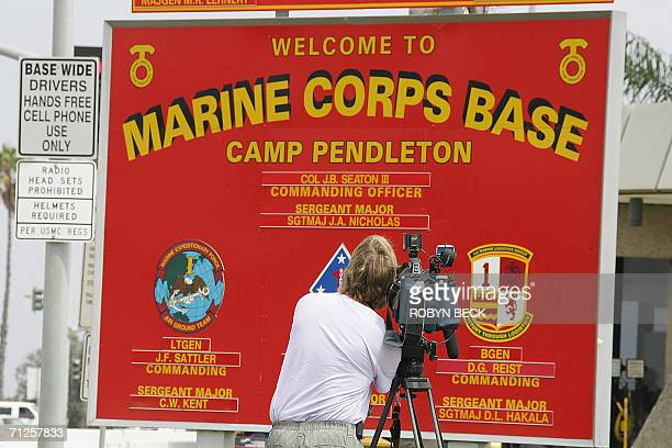 TV cameramn tapes footage of the sign at the entrance to Camp Pendleton Marine Corps Base in California 21 June 2006 The US Marines will announce...