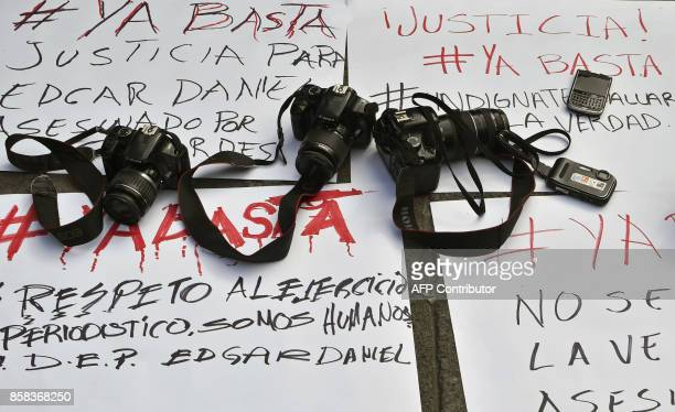 Cameras are placed on banners with messages of protest during a demonstration by photojournalists to demand justice for slain Mexican collegue Edgar...