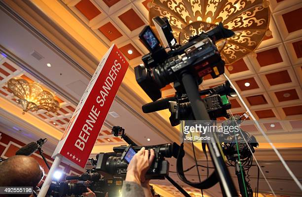 Cameras are raised in the air and aimed at Democratic presidential candidate Sen Bernie Sanders as he is interviewed in the spin rooom after he took...