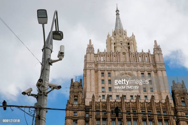 TOPSHOT CCTV cameras are seen on a lamp post next to the Russian Foreign Ministry headquarters in Moscow on March 28 2018 The Kremlin said on March...