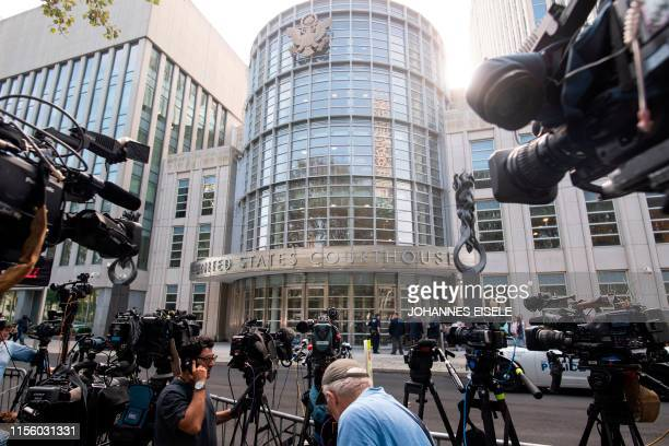 """Cameras are set up outside Brooklyn Federal Court on July 17 for Mexican drug lord Joaquin """"El Chapo"""" Guzman's sentencing, in New York. - After a..."""