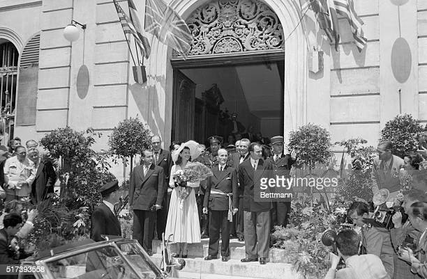 Cameras click as newlyweds Rita Hayworth and Prince Aly Khan and guests leave Vallauris City Hall May 27 following the couple's wedding