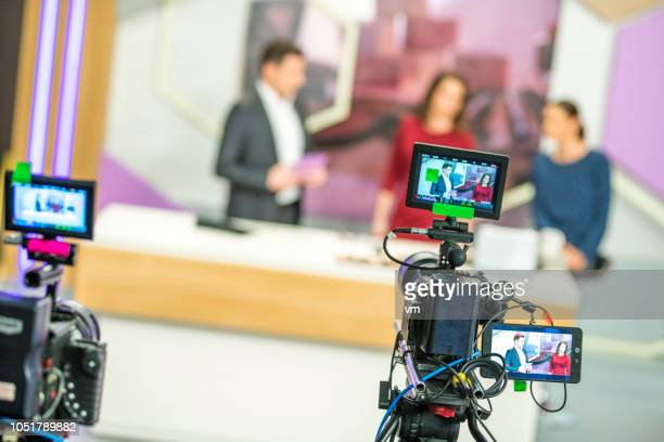 cameras filming a television talk show - stage set stock pictures, royalty-free photos & images