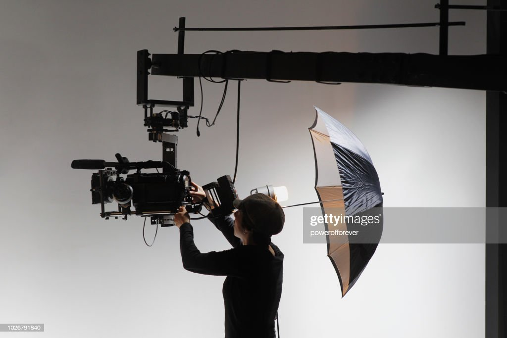 Camerawoman Behind the Scenes on a Film Set : Stock Photo