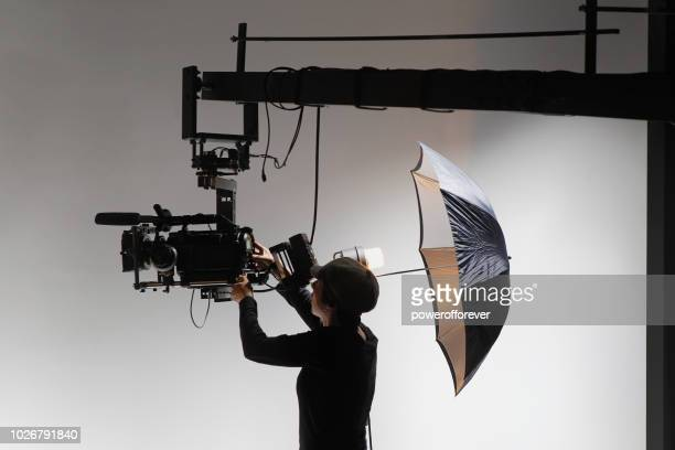 camerawoman behind the scenes on a film set - film studio stock pictures, royalty-free photos & images