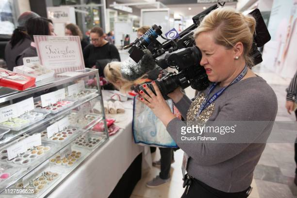 A camerawoman for a news network films some of the products on offer at The Chocolate Expo at Garden State Plaza Mall Paramus New Jersey January 2019