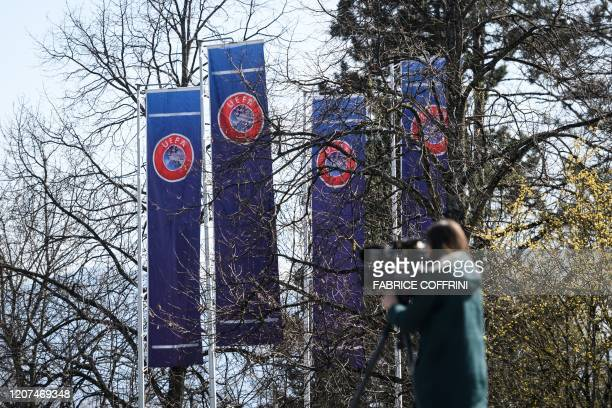 A TV camerawoman works at the UEFA headquarter in Nyon on March 17 amid spread of novel coronavirus UEFA has proposed postponing the European...