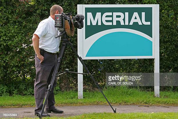 A camerman films the sign for livestock vaccine manufacturer Merial in Pirbright Surrey in southeast England 08 August 2007 A probe into Britain's...