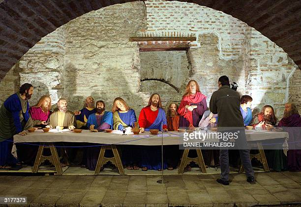 A camerman is filming The Last Supper made by wax figures in an public exhibition organized by the city museum of Bucharest 31 March 2004 The...