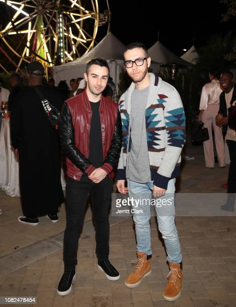 Cameron and Devin Lazerine of RapUp attend Rostrum AnnualHoliday Party on December 13 2018 in Los Angeles California