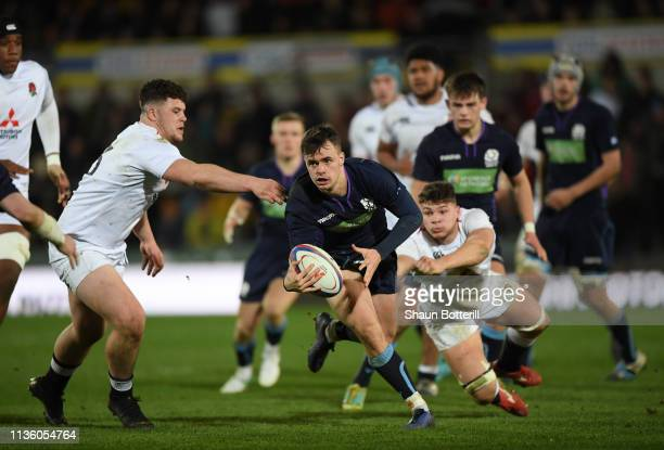 Cameron Anderson of Scotland is tackled by Alfie Barbeary and Aaron Hinkley of England during the Under 20 Six Nations match between England U20 and...
