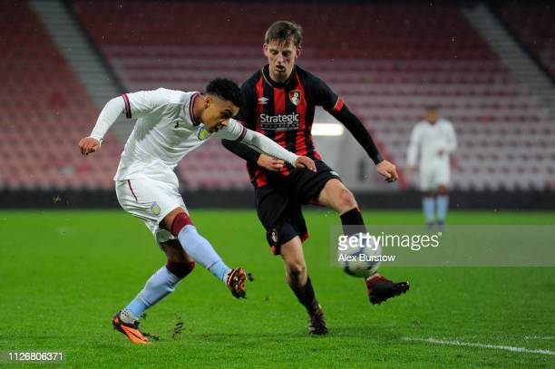 Cameron Archer of Aston Villa crosses the ball under pressure from Tom Hanfrey of AFC Bournemouth during the FA Youth Cup Fifth Round Match between...