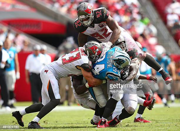 Cameron ArtisPayne of the Carolina Panthers is tackled during the fourth quarter of the game against the Tampa Bay Buccaneers at Raymond James...