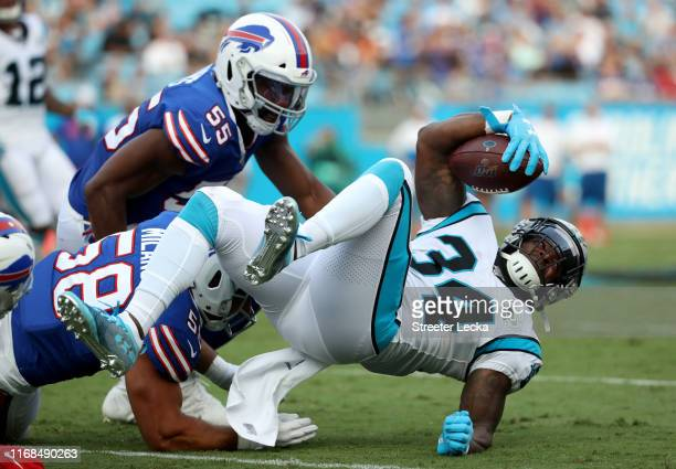 Cameron Artis-Payne of the Carolina Panthers runs the ball against the Buffalo Bills in the first quarter during the preseason game at Bank of...