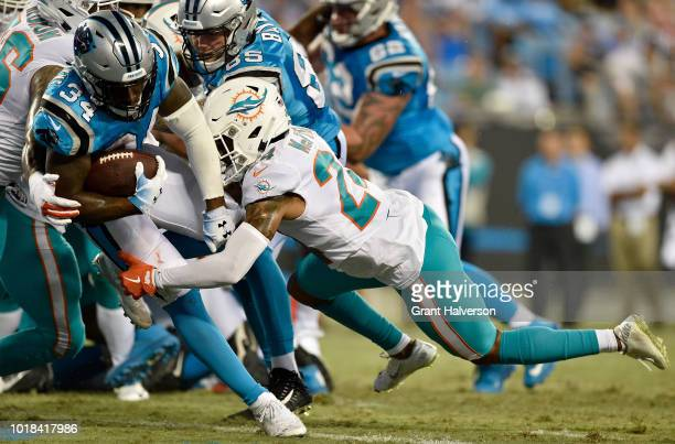 Cameron ArtisPayne of the Carolina Panthers scores a touchdown against Torry McTyer of the Miami Dolphins in the third quarter during the game at...