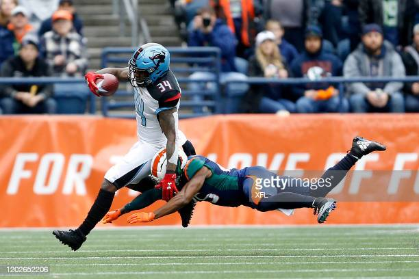 Cameron ArtisPayne of the Dallas Renegades gets around a Seattle Dragons defender during the XFL game at CenturyLink Field on February 22 2020 in...