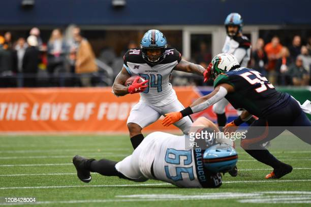 Cameron Artis-Payne of the Dallas Renegades stiff arms a defender during the XFL game against the Seattle Dragons at CenturyLink Field on February...