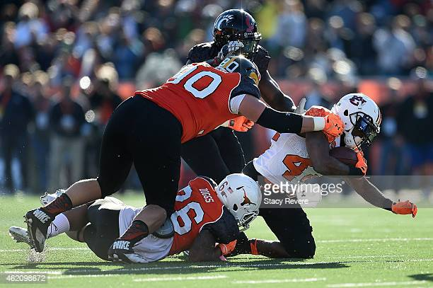 Cameron ArtisPayne of the South team is brought down by Quandre Diggs of the North team during the first quarter of the Reese's Senior Bowl at Ladd...