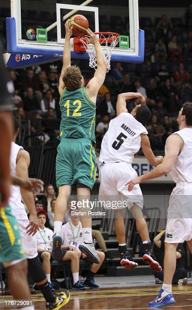 Cameron Bairstow of the Boomers dunks the ball during the Men's FIBA Oceania Championship match between the Australian Boomers and the New Zealand...
