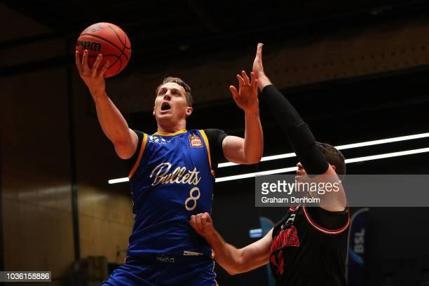 Cameron Bairstow of the Brisbane Bullets drives at the basket during the NBL Blitz preseason match between Brisbane Bullets and Illawara Hawks at...