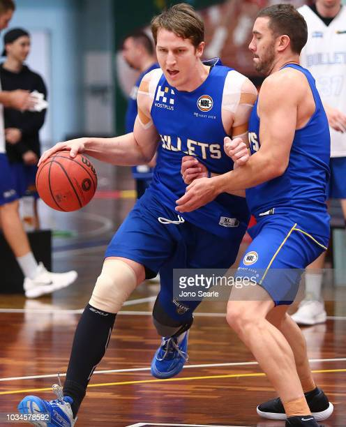 Cameron Bairstow of the Bullets drives past Adam Gibson during a Brisbane Bullets NBL training session on September 17 2018 in Brisbane Australia