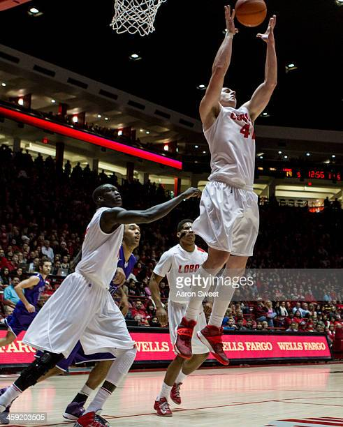 Cameron Bairstow of the New Mexico Lobos grabs a rebound during the game against the Grand Canyon Antelopes at The Pit on December 23 2013 in...