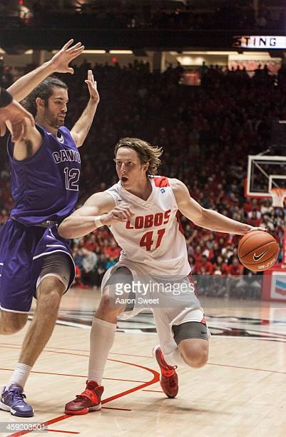 Cameron Bairstow of the New Mexico Lobos makes room to shoot as defender Daniel Alexander of the Grand Canyon Antelopes presses during the Monday...