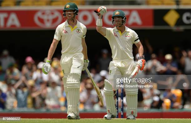 Cameron Bancroft and David Warner of Australia celebrate after Australia won the first Ashes cricket test match between Australia and England by ten...