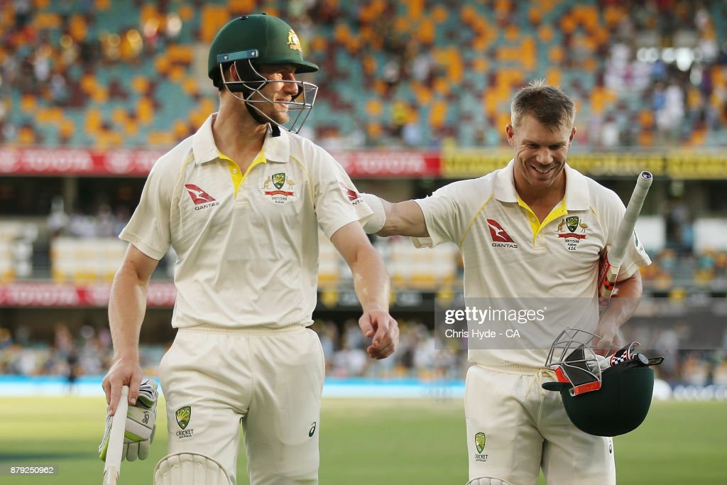 Cameron Bancroft and David Warner of Australia leaves the field at the end of play during day four of the First Test Match of the 2017/18 Ashes Series between Australia and England at The Gabba on November 26, 2017 in Brisbane, Australia.