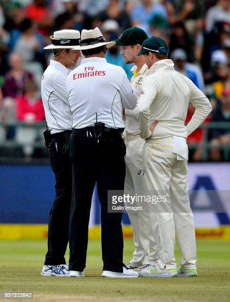Cameron Bancroft and Steven Smith of Australia having a chat with the umpires during day 3 of the 3rd Sunfoil Test match between South Africa and...