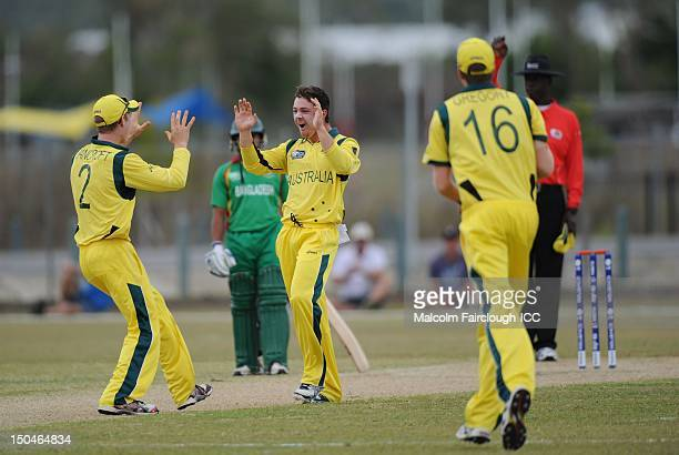 Cameron Bancroft celebrates with Travis Head during the ICC U19 Cricket World Cup 2012 Quarter Final match between Australia and Bangladesh at...