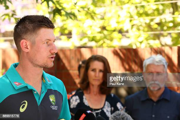 Cameron Bancroft of Australia addresses the media as his parents Frank and Linda look on after being added into the WACA ground's Test Player Walk...