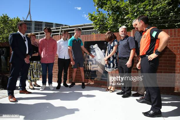 Cameron Bancroft of Australia admires a wall mounted image with family and Justin Langer after being added into the WACA ground's Test Player Walk...