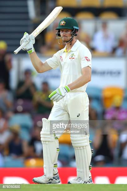 Cameron Bancroft of Australia celebrates after reaching his half century during day four of the First Test Match of the 2017/18 Ashes Series between...