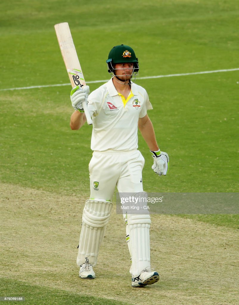 Cameron Bancroft of Australia celebrates and acknowledges the crowd after scoring a half century during day four of the First Test Match of the 2017/18 Ashes Series between Australia and England at The Gabba on November 26, 2017 in Brisbane, Australia.