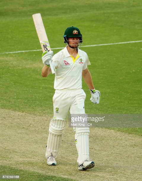 Cameron Bancroft of Australia celebrates and acknowledges the crowd after scoring a half century during day four of the First Test Match of the...