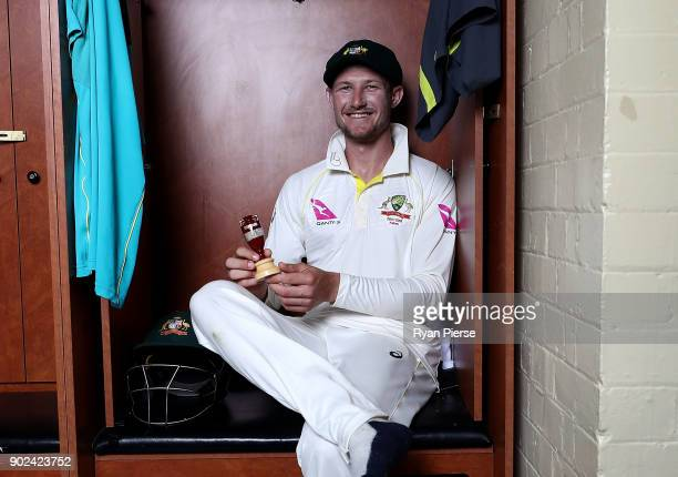 Cameron Bancroft of Australia celebrates with the Ashes Urn in the change rooms during day five of the Fifth Test match in the 2017/18 Ashes Series...